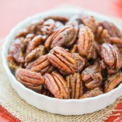 Candied Pecans In a White Low Dish on Burlap