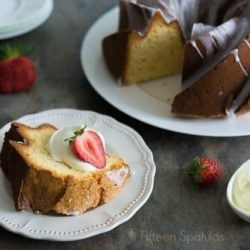 Cream Cheese Pound Cake on Plates with Cream and Berries