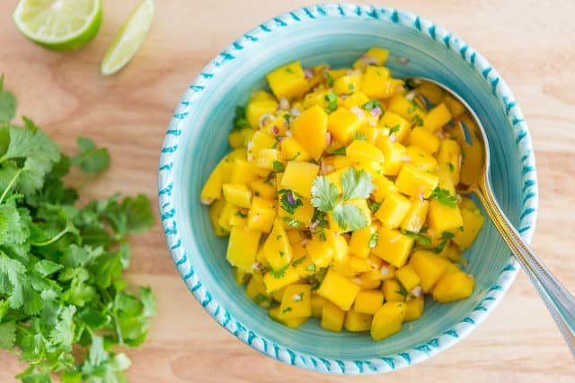 Mango Salsa in Bowl with Cilantro and Lime