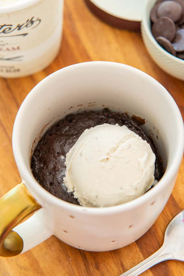 Gooey Chocolate Mug Cake - In Mug with Scoop of vanilla Ice Cream On top