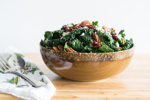 Kale Salad in Mixing Bowl With Pecans, Cranberries, and Feta