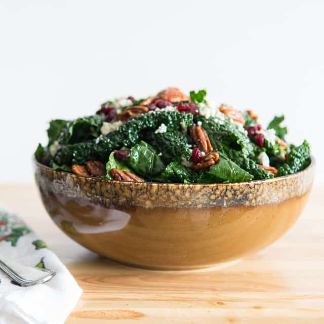 Kale Salad - with Cranberries, Candied Pecans, Blue Cheese, and Balsamic Vinaigrette in Brown Bowl