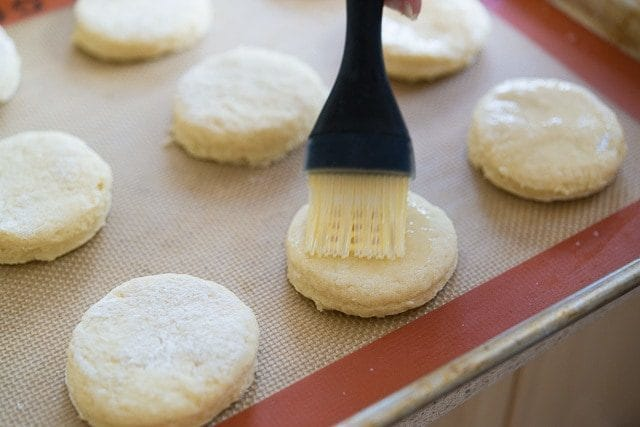 Brushing Homemade Scones with Egg Wash on Silicone Mat