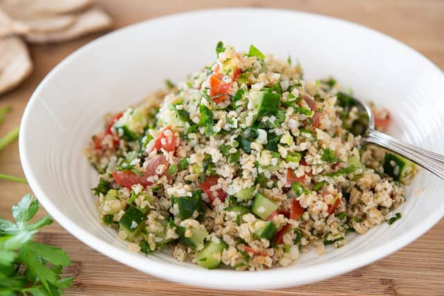 Tabbouleh Recipe - Served in a White Dish on Wooden board