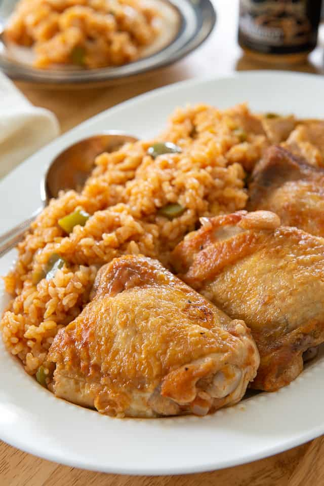 Arroz Con Pollo - Served on a White Platter with Spoon and Made from Kathy\'s 8x8 Cookbook