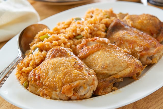 Arroz Con Pollo Recipe - Chicken thighs cooked in a flavorful broth with rice