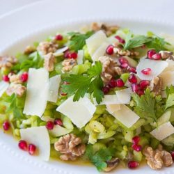 Celery Salad On White Platter with Pomegranate and Cheese