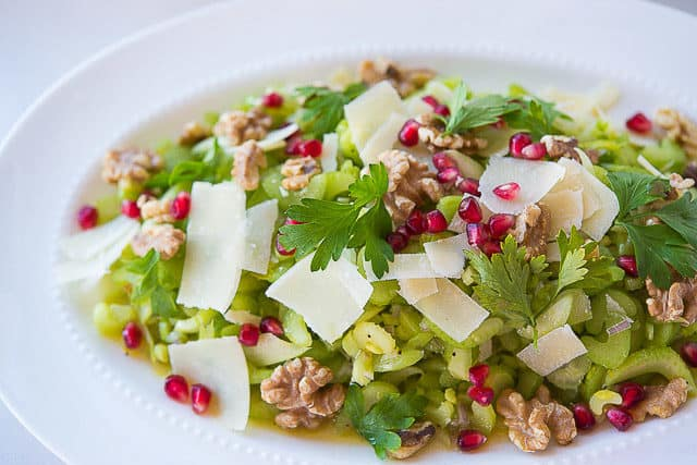 Celery Salad - On White Platter with Pomegranate and Cheese