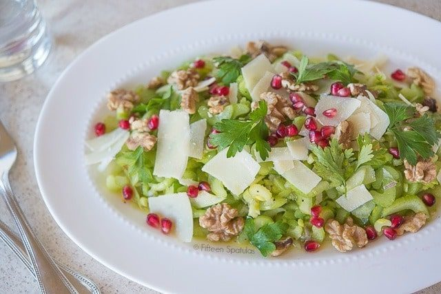 Crisp and refreshing celery salad recipe with walnuts, parmesan cheese, and pomegranates. Great side dish or entertaining recipe!