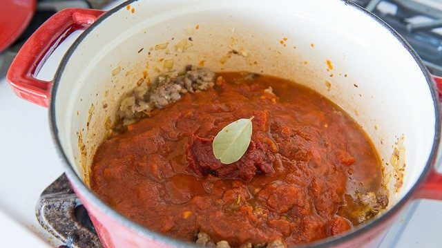 Tomato Sauce and Bay Leaf Added to Pot
