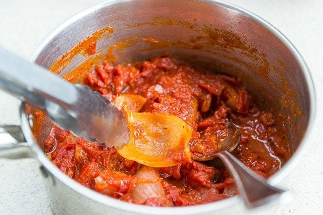 This tomato sauce recipe is incredibly easy to make, it's life-changing. Best simple tomato sauce I've ever tasted! Recipe from Marcella Hazan.