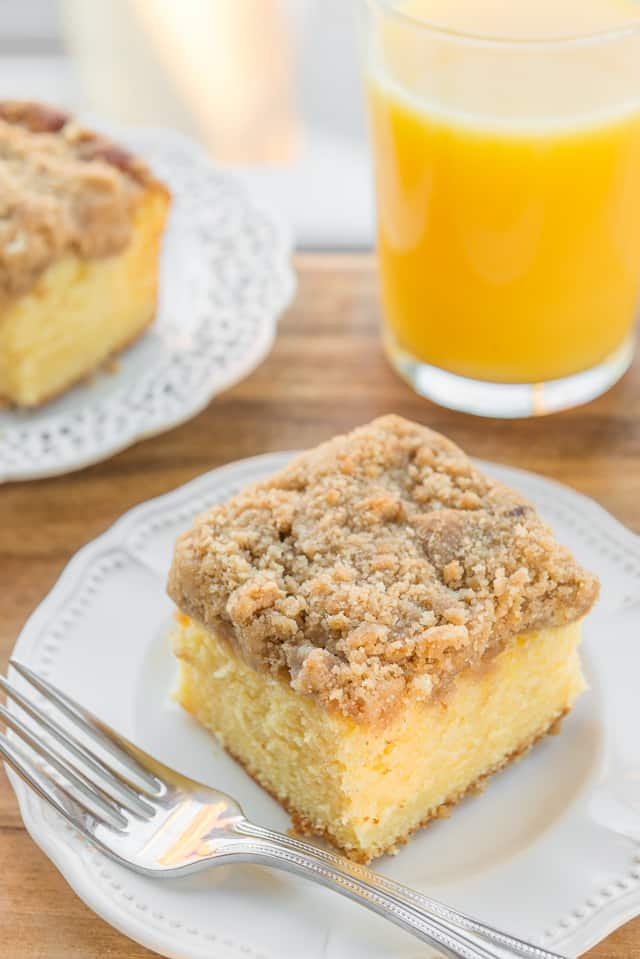 Orange Coffee Cake - Served on White Plate with Orange Juice and Streusel Crumb Topping