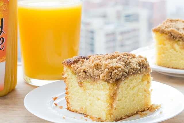 Coffee Cake - On White Dish With Orange Juice in the Background and Streusel Topping