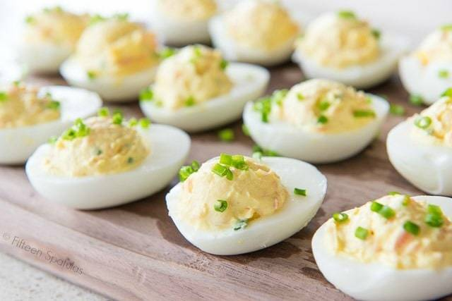 Smoked Salmon Deviled Eggs always disappear in a flash when I bring them to parties! This classic appetizer recipe has smoked salmon, goat cheese, sour cream, a little lemon, and chives.