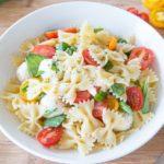 Caprese Pasta Salad Recipe - in White Dish on Wooden Board