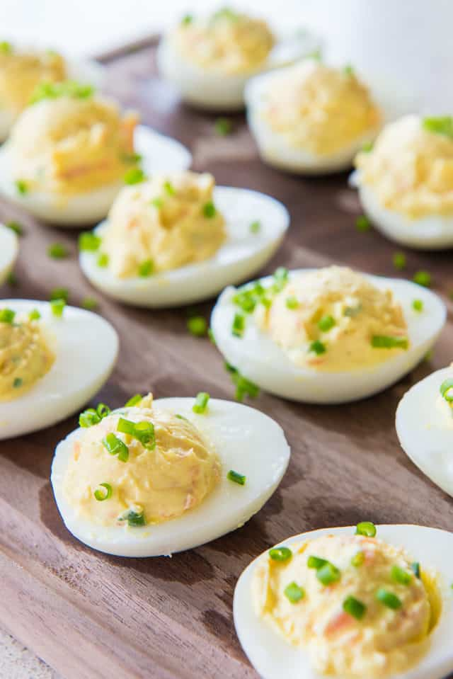 Smoked Salmon Deviled Eggs - On a Platter sprinkled with Fresh Chives