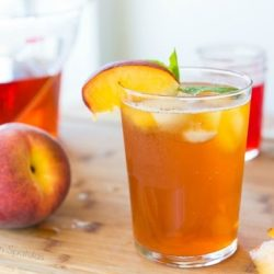 Sparkling Peach Iced Tea in a Glass with Peach Simple Syrup