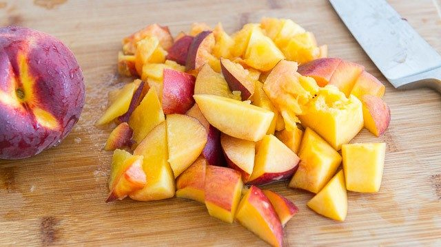 Chopped Fresh Peaches on a Cutting Board