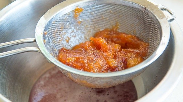Straining Peaches in Fine Mesh Strainer