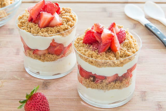 Strawberry Cheesecake Parfait Dessert in Glasses with Fresh Strawberries