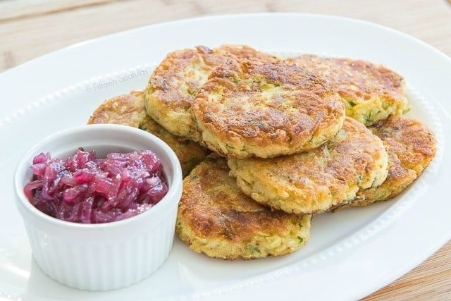 Stacked Chickpea Zucchini Fritters on Platter with Red Onion Marmalade on Side