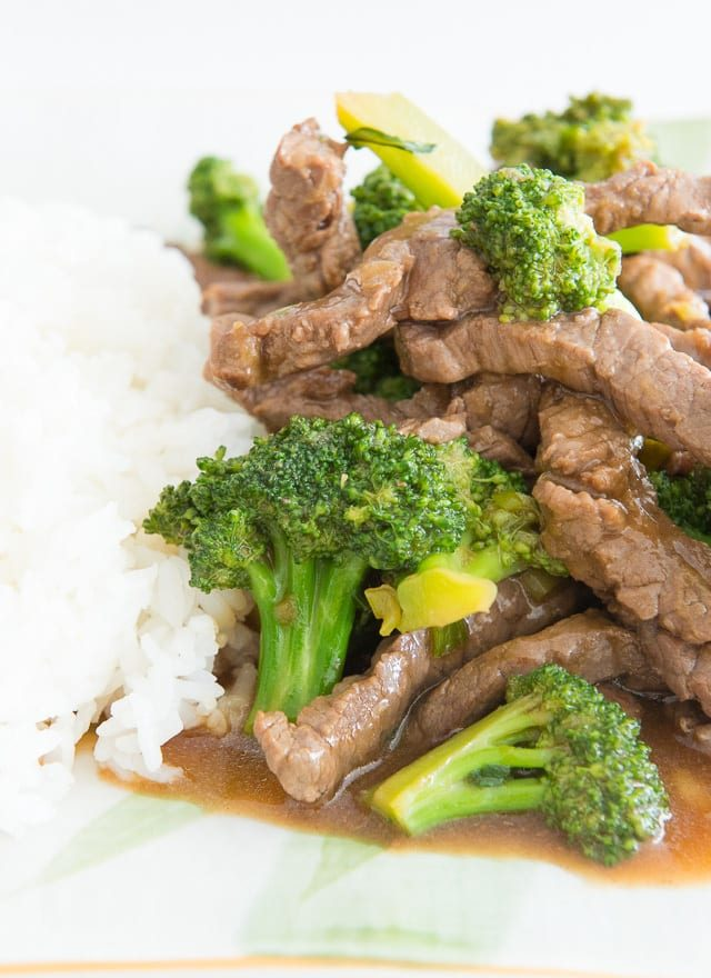 Beef and Broccoli Recipe - Shown Plated with Steamed White Rice on White Platter