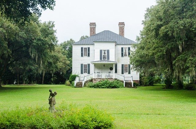 A Plantation Home with Green Lawn