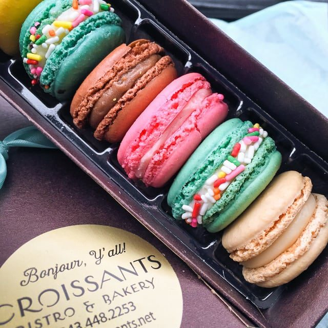 A bunch of macarons in a box
