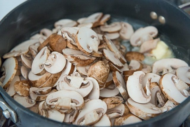 Sliced Mushrooms in Butter in Skillet