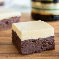 Irish Cream Brownies on Cutting Board with Caramelized White Chocolate Buttercream