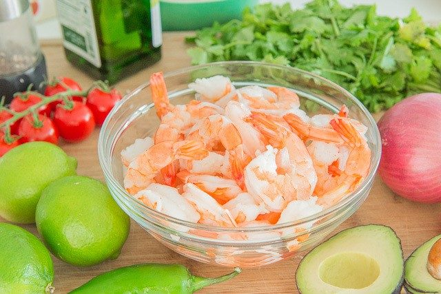 Bowl of Shrimp on Wooden Board with Jalapeno, Lime, and Cilantro