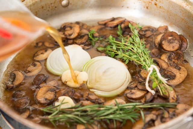 Mushrooms with Beef Stock, Thyme, Rosemary, Onion, and Garlic