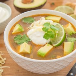 Slow Cooker White Chicken Chili - In a Bowl Garnished with Lime and Cilantro