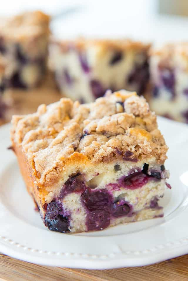 Blueberry Buckle - On a Plate with Remaining Cake in Background