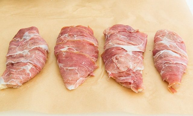 Chicken breasts wrapped in thinly sliced prosciutto