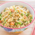 Cauliflower Fried Rice - In a Bowl with Chicken, Peas, Carrots