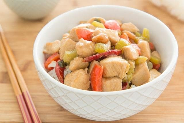 Kung Pao Chicken Recipe Served in White Bowl with Chopsticks