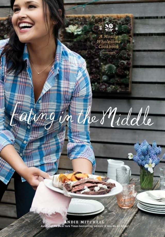 Andie Mitchell sitting at a table eating food for Cookbook Cover