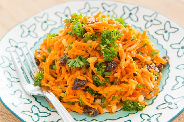 Carrot and Raisin Salad - With Parsley On Top of Blue Plate