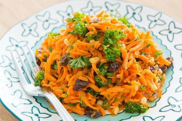 This gorgeously vibrant Fresh Carrot Raisin Salad is full of flavor but light on calories!