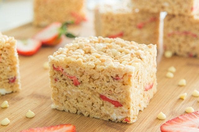 A Square of Strawberry Rice Crispy on a Cutting Board