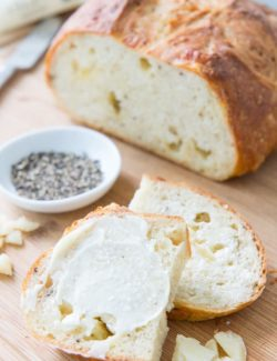 Asiago Black Pepper Bread - Sliced and Spread with Fresh Butter