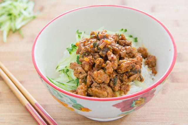 Korean Chicken Rice Bowl with Shredded Cucumber and Chopsticks