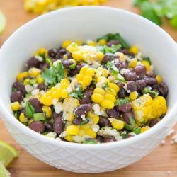 Mexican Corn Salad with Black Beans and Cotija Cheese in White Bowl