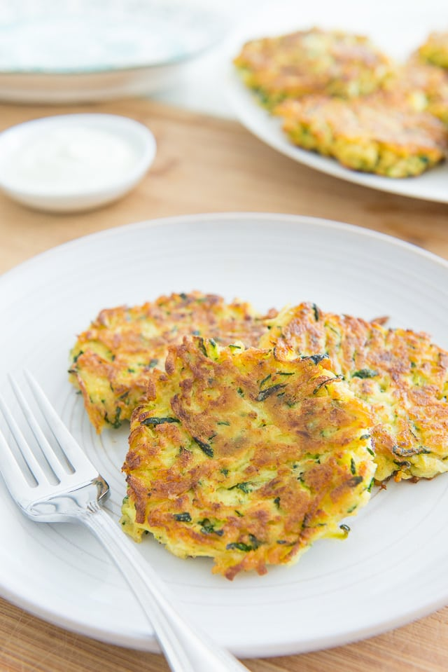 Zucchini Fritters - Takes less than 15 minutes to make! #zucchini #zucchinifritters #fritter #quickrecipes