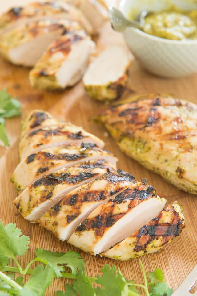 Chicken breasts are marinated in a tropical mixture of mango, cilantro, coconut, and ginger, then thrown on the grill. The chicken breasts turn out so juicy and flavorful!