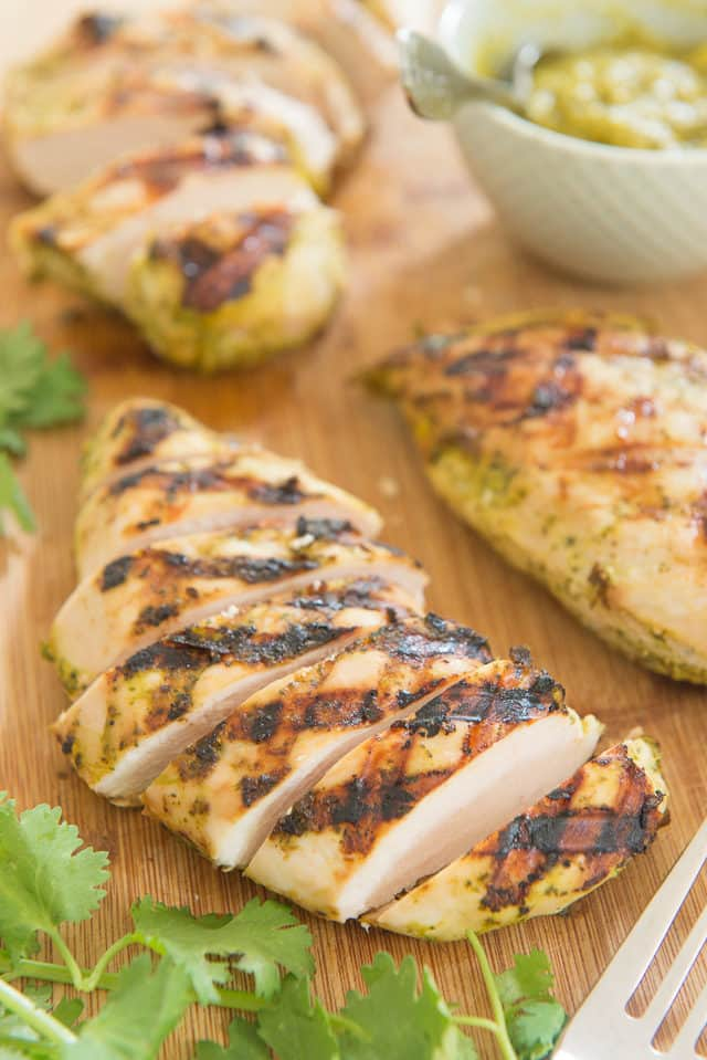 Slices of grilled chicken marinated in mango, cilantro, and coconut