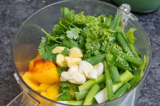Garlic, Ginger, Scallion, Cilantro, and Mango in Food Processor Bowl