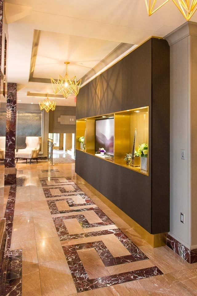 Purple Marble Design And Golden Chandelier Light Fixtures In Hotel LeVeque Columbus, Ohio