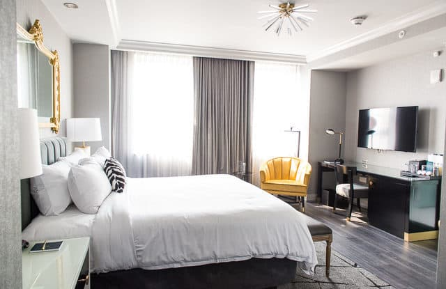 A guest room in Hotel Leveque in Columbus Ohio with art deco feel and celestial design